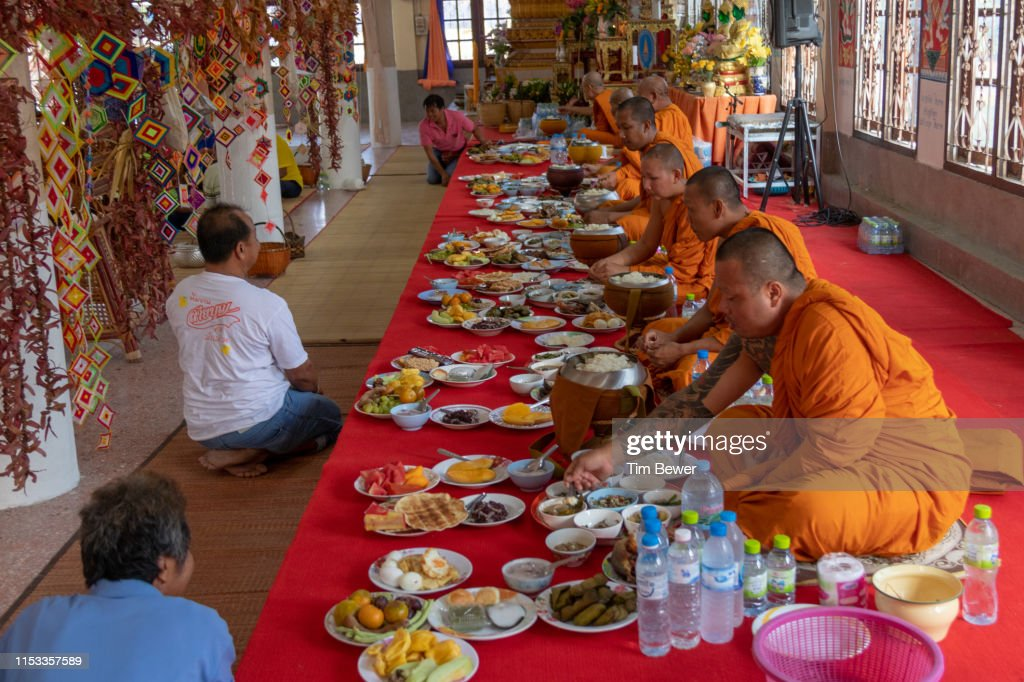 Buddhist monks eating lunch at a temple. : Stock Photo