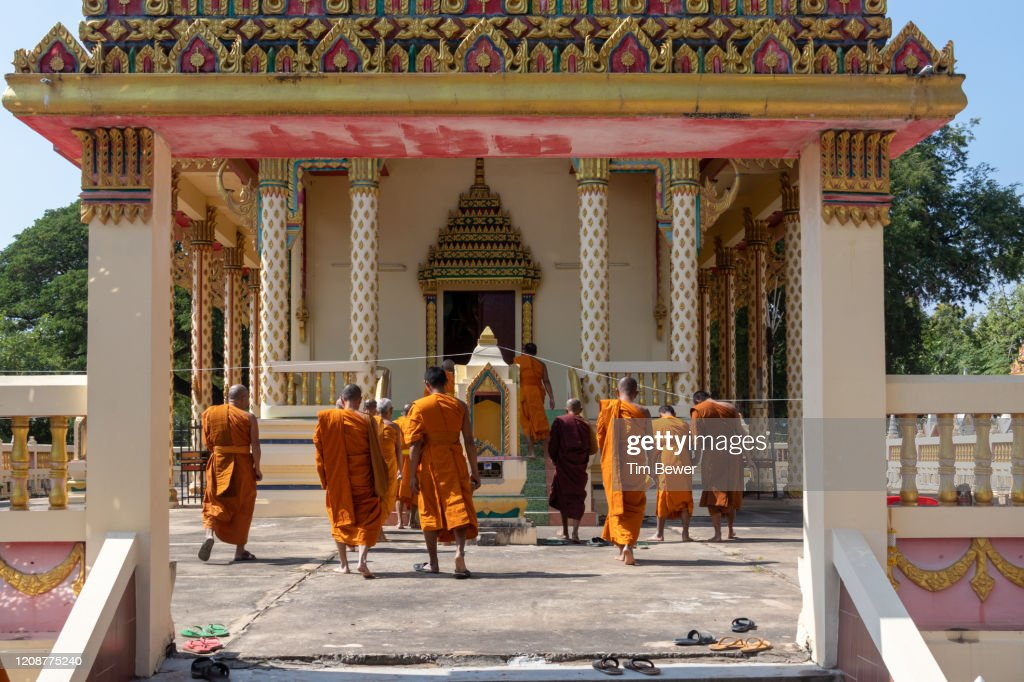 Buddhist monks entering ubosot before confessional meeting. : Stock Photo
