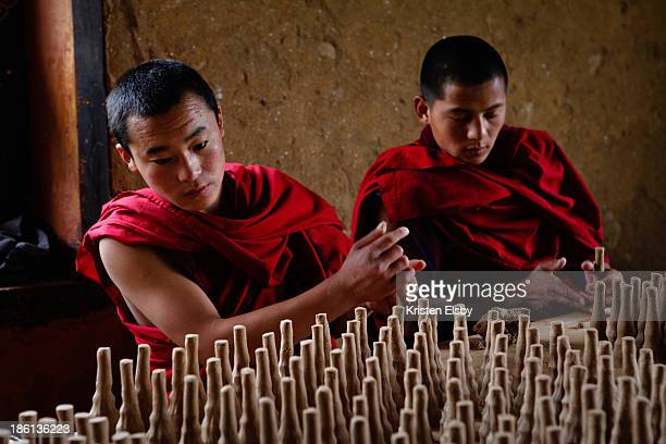 Buddhist monks fashion 'torma', or butter cakes, made of buckwheat flour and hardened butter for use in ceremonial rituals. The finished forms are...