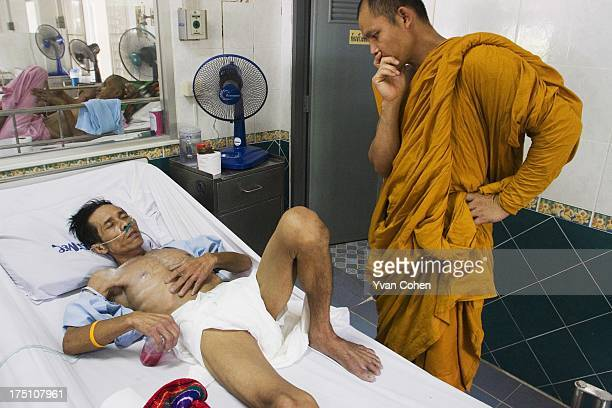 Buddhist monks from a temple in the Thai capital Bangkok visit AIDS sufferers at the Wat Prabat Nam Phu temple The monks come to learn more about the...