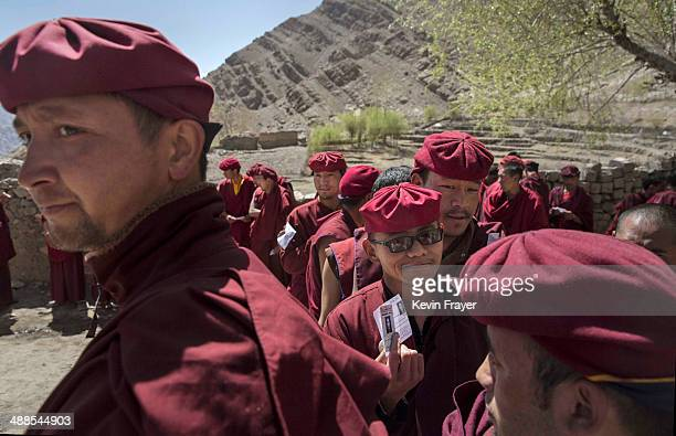 Buddhist monks from the Drukpa lineage wait outside a polling station to vote near the Hemis Monastery on May 7 2014 in Hemis Ladakh India India is...