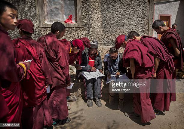 Buddhist monks from the Drukpa wait outside a polling station to vote near the Hemis Monastery on May 7 2014 in Hemis Ladakh India India is in the...
