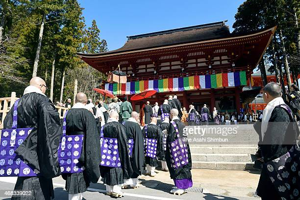 Buddhist monks gather at the newly reconstructed Garan Chumon gate for the memorial ceremony to mark the 1200th anniversary of its founding at Mount...