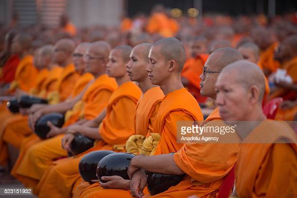 Buddhist monks hold alms bowl as over 100000 buddhist monks and novices gather at Wat Dhammakaya Temple before the 'AlmsOffering Ceremony' to mark...