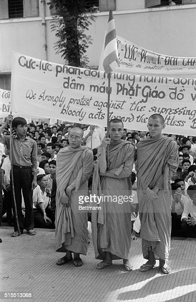 Buddhist monks hold signs protesting religious policies of President Ngo Dinh Diem August 18 in memorial services at main Xa Loi Pagoda here Services...