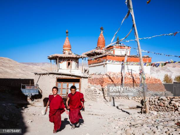 buddhist monks in a village, upper mustang, nepal - lo manthang stock pictures, royalty-free photos & images