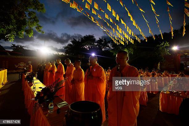 Buddhist monks in chanting prayers during a celebration for the birthday of Longwuye at Nanshan Buddhist Culture Park on June 28 2015 in Sanya Hainan...