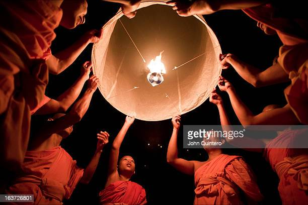 CONTENT] Buddhist monks launch a sky lantern or khom loy as its known in Thailand during the Yee Peng Festival in Chiang Mai By releasing the...