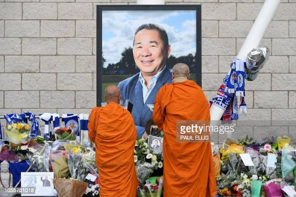 TOPSHOT Buddhist monks lay tributes by a photograph of Leicester City Football Club's Thai chairman Vichai Srivaddhanaprabha outside Leicester City...