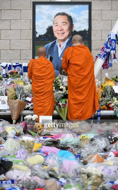 Buddhist monks lay tributes by a photograph of Leicester City Football Club's Thai chairman Vichai Srivaddhanaprabha outside Leicester City Football...