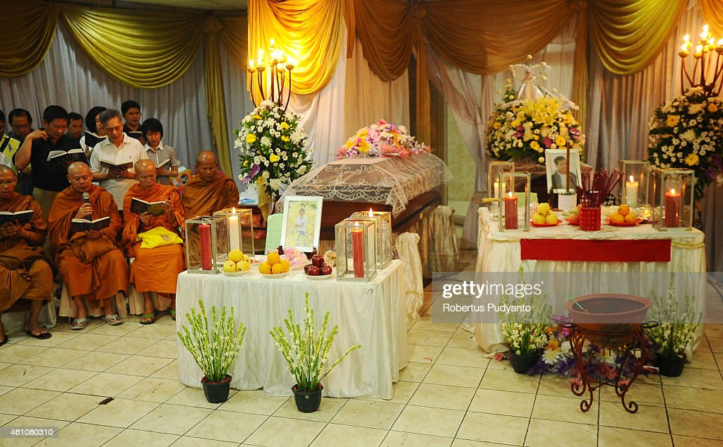Buddhist monks lead a prayer for Brian Youvito Jou (left coffin) and Yongki Jou (right coffin), victims of the AirAsia flight QZ8501 disaster at Adi Yasa funeral house on January 6, 2015 in Surabaya, Indonesia. A massive recovery operation is underway in waters off Borneo to recover bodies and debris from the missing AirAsia plane. AirAsia announced that flight QZ8501 from Surabaya to Singapore, with 162 people on board, lost contact with air traffic control at 07:24 a.m. local time on December 28.