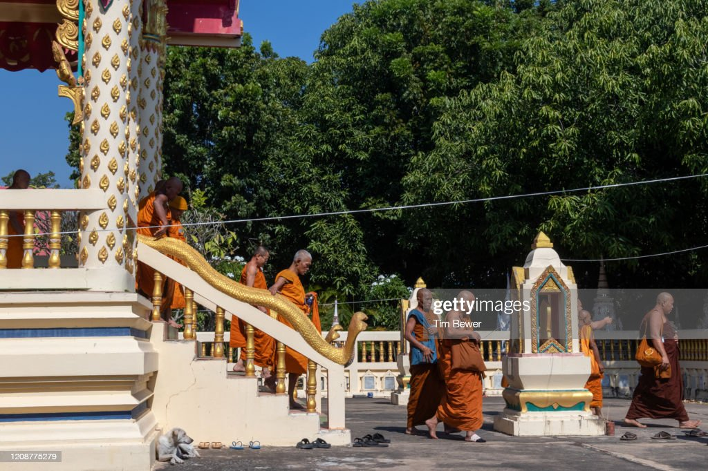 Buddhist monks leaving ubosot after confessional meeting. : Stock Photo