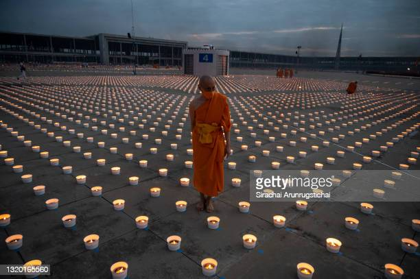 Buddhist monks light 180,000 candles, arranged in the images of the birth, enlightenment and nirvana of Gauttama Buddha during Vesak Day celebration...