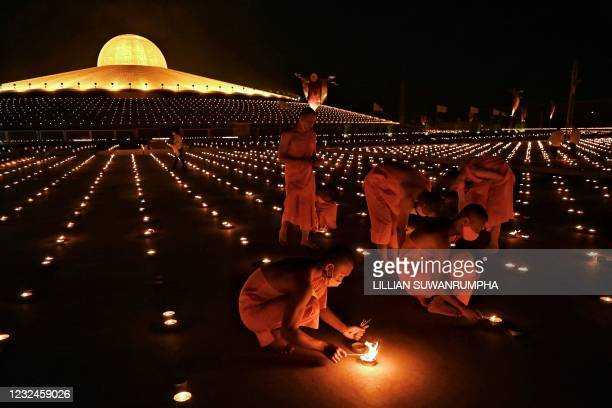 Buddhist monks light 330,000 candles in an attempt to break the Guinness World Record for the largest flaming image during Earth Day celebrations at...