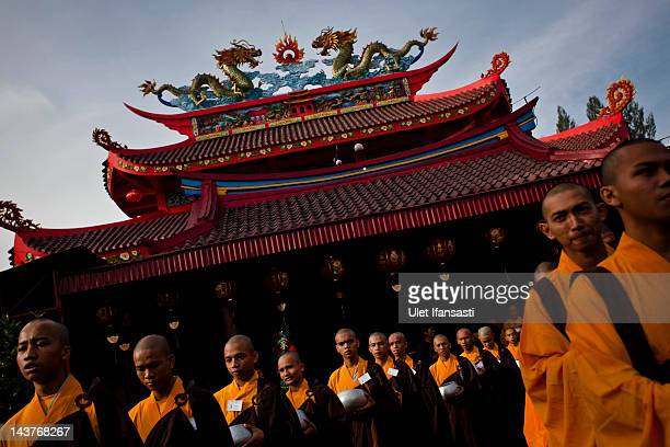 Buddhist monks line up as they prepare to receive alms from Buddhist religious members of the public ahead of Vesak Day on May 3 2012 in Magelang...