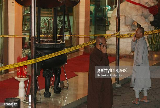 Buddhist monks looking at Bomb Squad Police officers when investigate the crime scenes at Ekayana Buddhist Temple District Duri Kepa Tanjung Duren on...