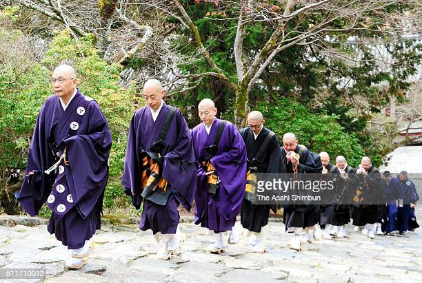 Buddhist monks march on during the 'Shasan' visit of halls in the premises ahead of the 'Shunie' or Omizutori ritual at Todaiji Temple on February 21...