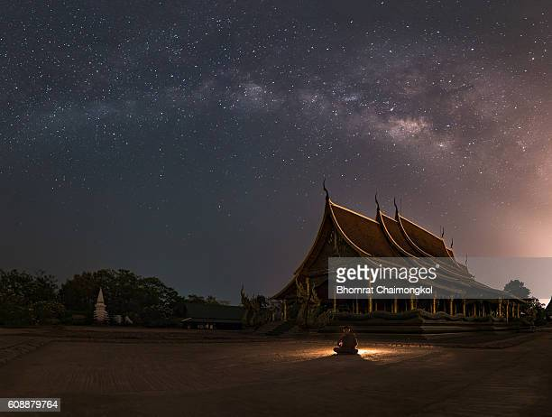 Buddhist monks meditation at Temple Sirindhorn Wararam Phuproud in Ubon Ratchathani Province at night time,Thailand