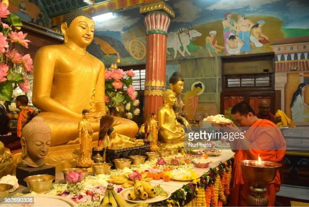 Buddhist monks offer prayers at the celebrate the full-moon day, also know as Buddha Day, in Kolkata,India, Sunday, April 29, 2018.