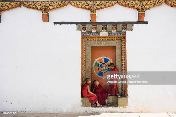buddhist monks, paro dzong, paro, bhutan, asia - monk stock pictures, royalty-free photos & images