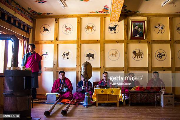Buddhist monks playing long horns and percussion symbols on November 18 2012 in Bumthang Bhutan