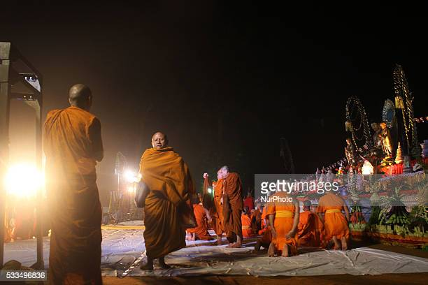 Buddhist monks pray at the Borobudur temple during celebrations for Vesak Day on May 22 2016 in Magelang Central Java Indonesia Vesak day ceremony...