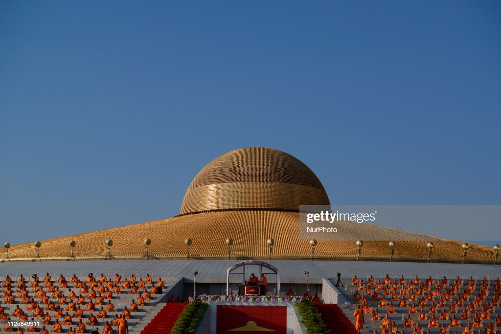 Buddhist Monks Pray At The Wat Phra Dhammakaya Temple During A