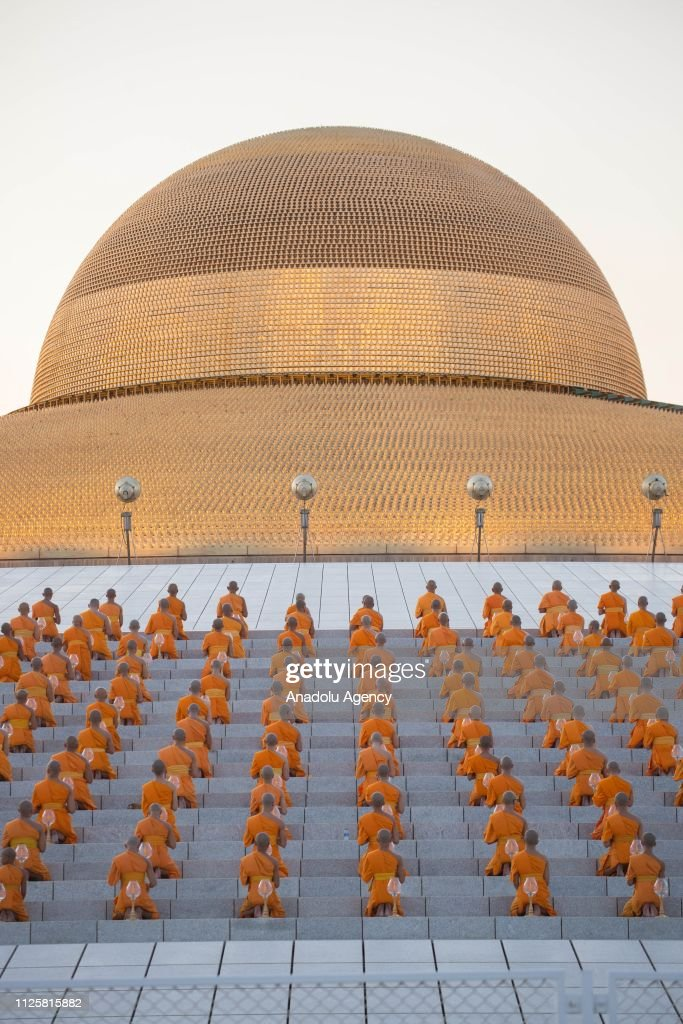 Buddhist Monks Pray During A Yearly Ceremony At Wat Phra Dhammakaya