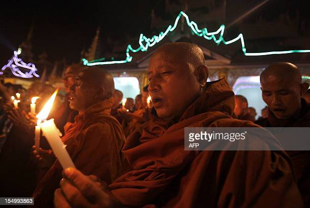 Buddhist monks pray for the Rakhine victims on the platform of Shwedagon pagoda on October 30 2012 while thousands of worshipers came to the pagoda...
