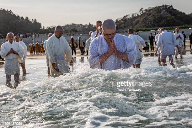 Buddhist monks pray for the victims of the 2011 Tohoku earthquake and tsunami at a beach on March 11, 2021 in Iwaki, Japan. Japan will today observe...