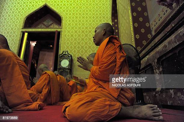 Buddhist monks pray inside the Marble Temple in Bangkok on July 17 on Asarnha Bucha Day Asarnha Bucha Day commemorates the first occasion when the...