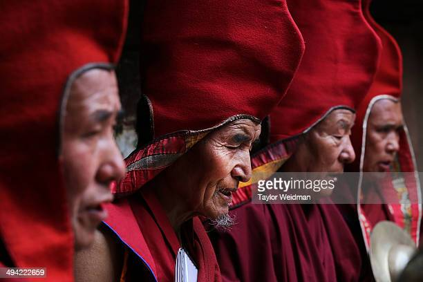 Buddhist monks pray while performing a ceremony in the former King's palace during the Tenchi Festival on May 25, 2014 in Lo Manthang, Nepal. The...