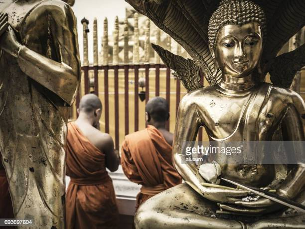 buddhist monks praying at phra that doi suthep chiang mai thailand - buddha's birthday stock pictures, royalty-free photos & images