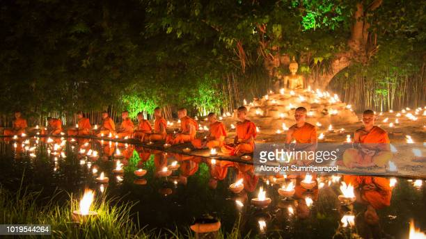 Buddhist monks praying for Asalha Puja Day at Wat Phan Tao temple, Chiangmai, Thailand.