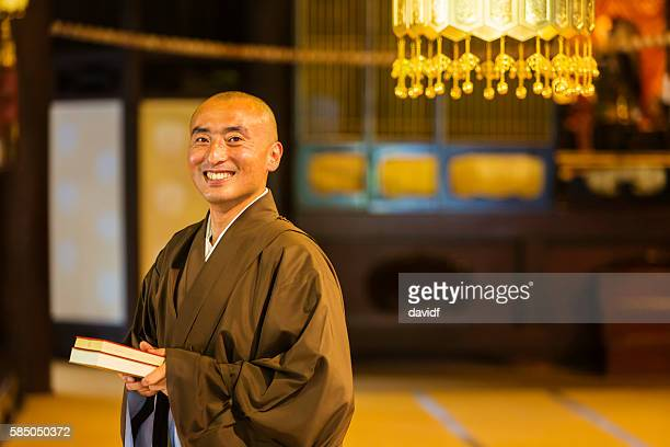 buddhist monks praying in a traditional japanese temple - monk stock pictures, royalty-free photos & images