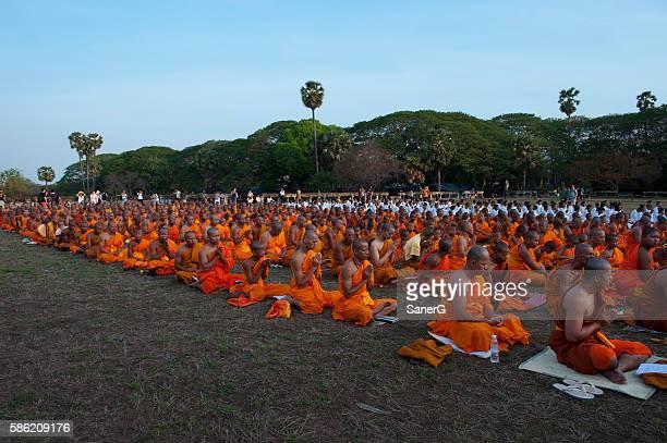 Buddhist monks praying in Angkor Wat