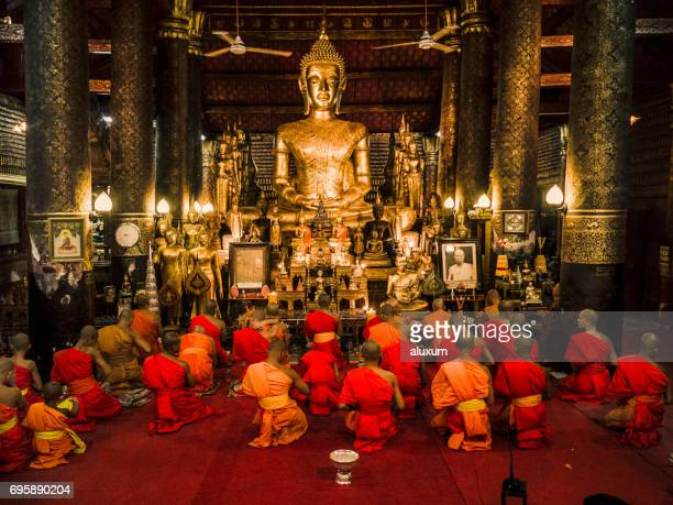 Buddhist monks praying in Wat Mail during Vesak Luang Prabang Laos