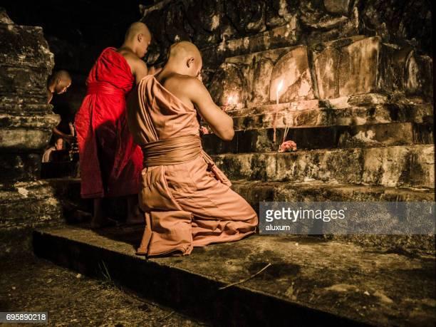 buddhist monks praying in wat mail during vesak luang prabang laos - buddha's birthday stock pictures, royalty-free photos & images