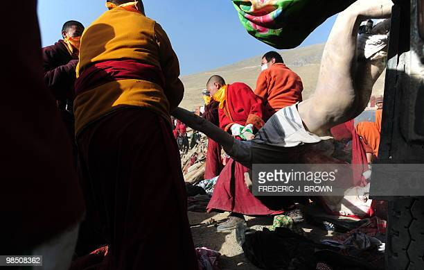 Buddhist monks prepare the bodies of earthquake victims for a mass cremation on a hillside in Jiegu, Yushu County, on April 17, 2010. China began the...