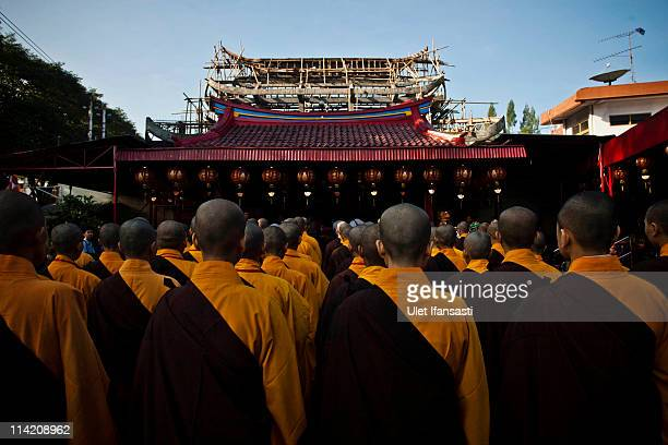 Buddhist monks prepare to receive religious alms from Buddhist members of the public ahead of Vesak Day commonly known as 'Buddha's birthday' at...