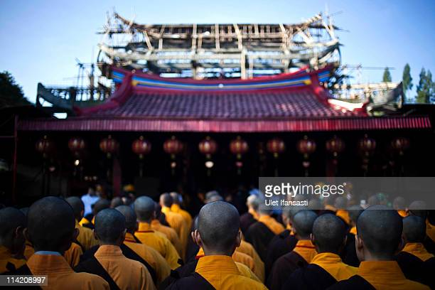 Buddhist monks prepare to receive religious alms from Buddhist members of the public ahead of Vesak Day commonly known as 'Buddha's birthday' at the...