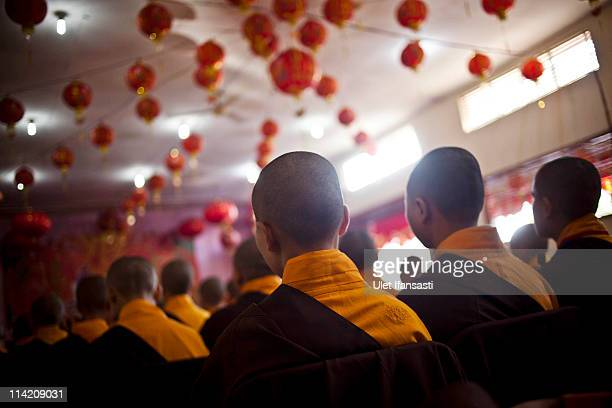 Buddhist monks prepare to receive religious alms from Buddhist members of the public ahead of Vesak Day commonly known as 'Buddha's birthday' on May...