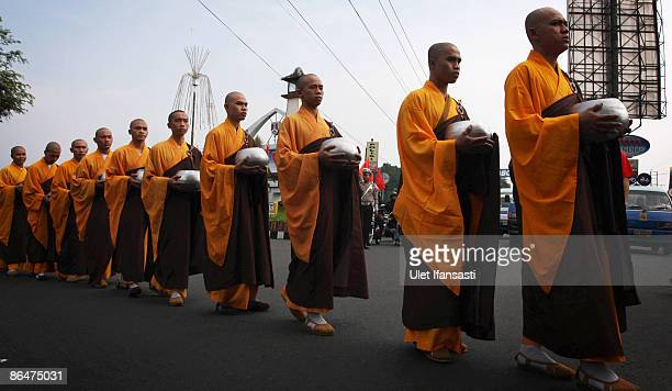 Buddhist monks prepare to receive religious meals from Buddhist members of the public on Vesak Day commonly known as 'Buddha's birthday' at the...