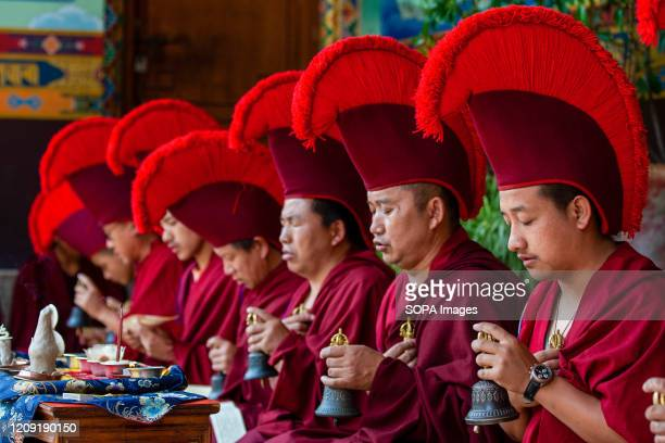 Buddhist Monks recite Holy Scriptures in a special religious prayer remembering the COVID-19 victims during the thirteenth day of nationwide...