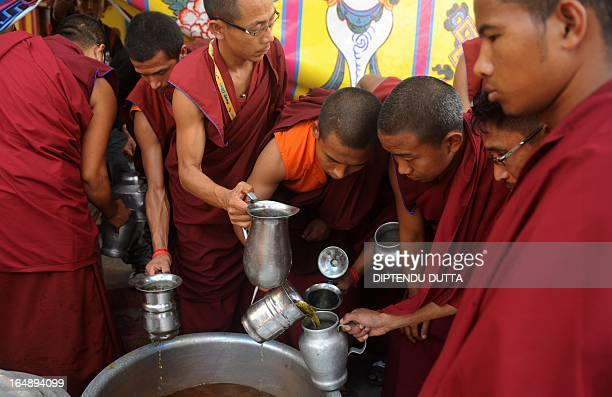 Buddhist monks serve holy water during the final day of spiritual lessons with the Tibetan spiritual leader the Dalai Lama at the Kalachakra Phodong...