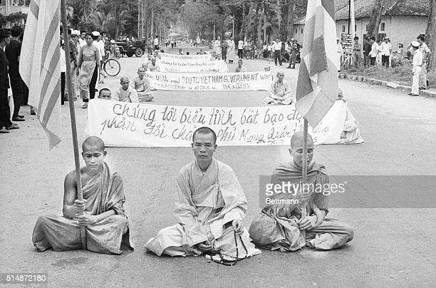 Buddhist monks sit in a Vung Tau street during a protest against the South Vietnamese government and the United States during the Vietnam War.