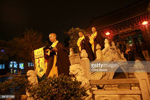 Buddhist monks take part in a Buddhist mass to see in the New Year at a Buddhist temple on January 1 2009 in Kunming of Yunnan Province China Cities...
