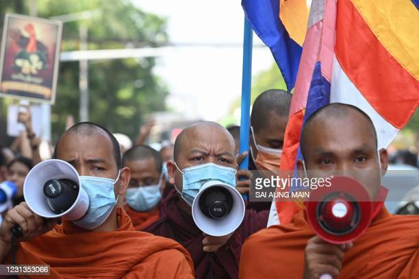 Buddhist monks take part in a demonstration against the Myanmar military coup outside the Indonesia embassy in Yangon on February 24, 2021.