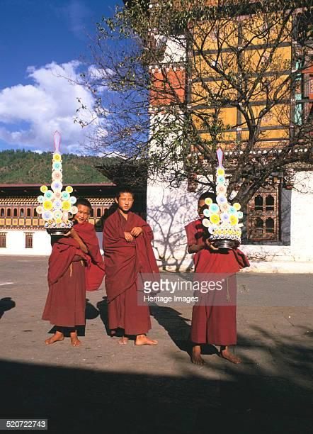 Buddhist monks Tashichho Dzong Thimphu Bhutan The Tashichho Dzong is the seat of Bhutan's government and the residence of the country's head abbott...