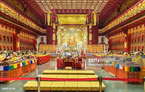Buddhist monks together to pray inside Buddha Tooth Relic Temple in China Town, Singapore. Photo takes on April 28, 2014.